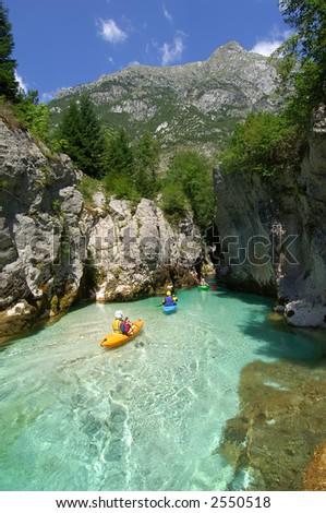 Kayaking through river gorge - stock photo