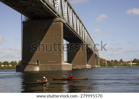 Kayaking towards The Old Littlebelt Bridge close to Middelfart in Denmark - stock photo