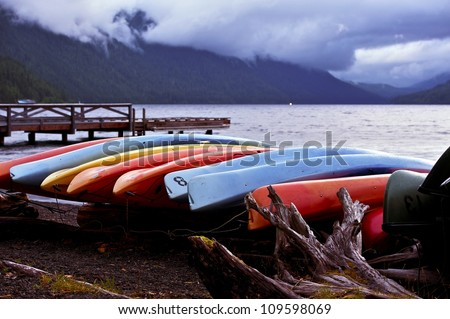 Kayaks and Lake Crescent. Rain Summer Day. Famous Places Photo Collection