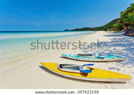 Kayaks at the tropical beach at Phu Quoc island  in Vietnam - stock photo