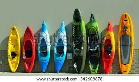 Kayaks for sale at sporting goods store - stock photo