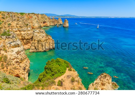 Kayaks on turquoise sea water at Ponta da Piedade, Algarve region, Portugal