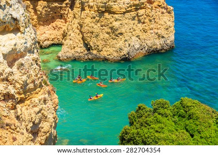 Kayaks on turquoise sea water at Ponta da Piedade, Algarve region, Portugal - stock photo