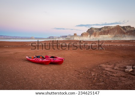 Kayaks Sit on the Receding Shoreline of Lake Powell (Glen Canyon National Recreation Area)