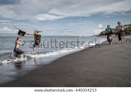 Kayangan beach, East Lombok, Indonesia - April 22, 2017 : Men from the Sasak tribe in Lombok performing a traditional martial art and dance on the beach with drums
