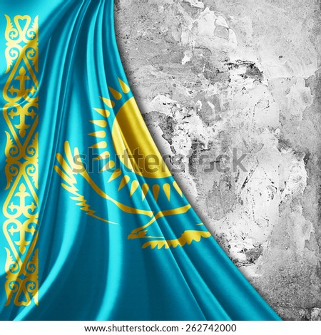 Kazakhstan flag and wall background - stock photo