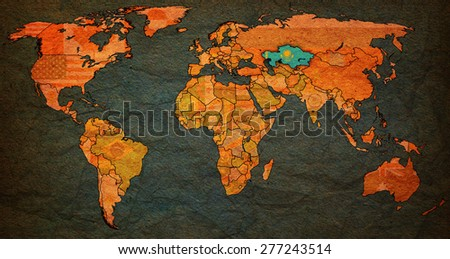 kazakhstan flag on old vintage world map with national borders - stock photo