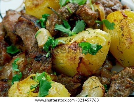 kazan-kebab - fried meat and potatoes .Central Asian cuisine