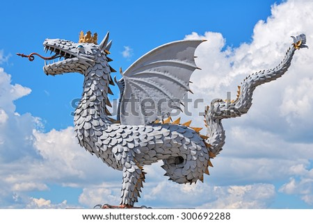KAZAN, RUSSIA - JULY 25, 2015: Metal sculpture of the winged snake Zilant, official symbol of Kazan. The sculpture was unveiled in 2003 to commemorate the 1000th anniversary of the city. - stock photo