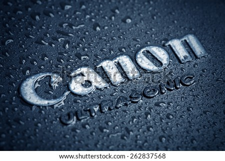 KAZAN, RUSSIA, 15 March 2015: water drops on the Canon logo