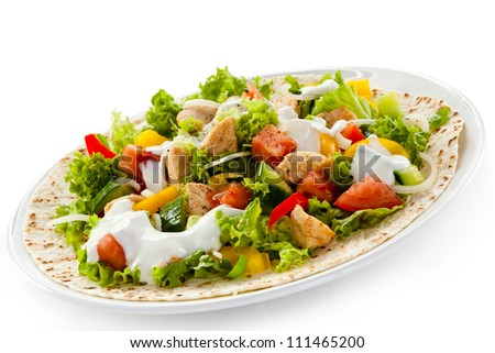 Kebab - grilled meat and vegetables on white background - stock photo