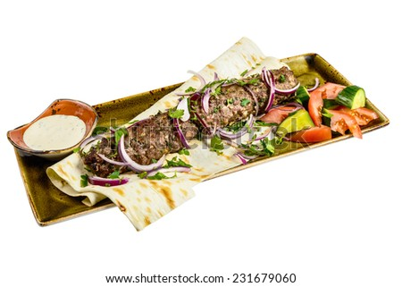 Kebab with pita bread on a plate. Isolated on white background. - stock photo