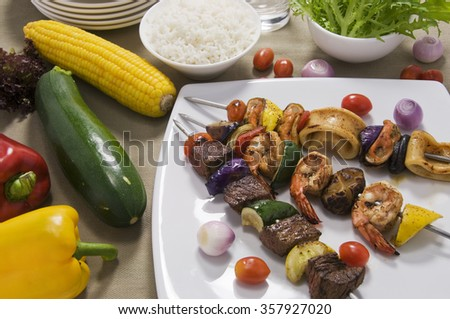 kebabs and Vegetables on Table - stock photo