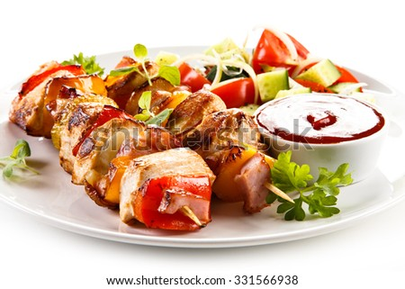 Kebabs - grilled meat and vegetables  - stock photo
