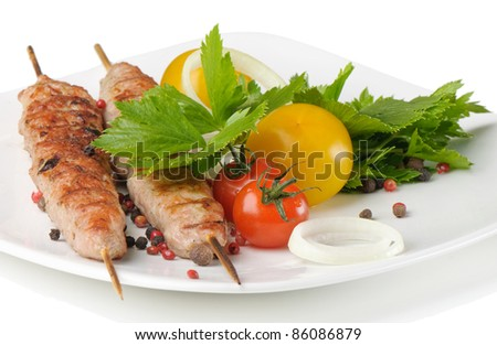 kebabs served with tomatoes and parsley - stock photo
