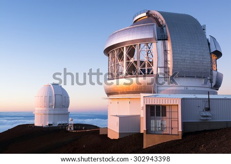 Keck observatory on Mauna Kea, at 14,000 feet, on the big island of Hawaii during sunset. - stock photo