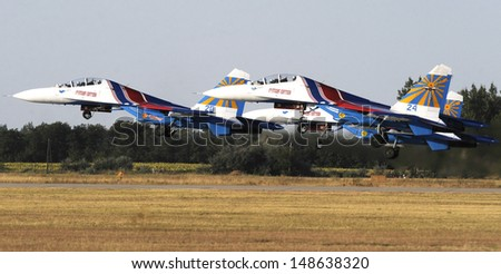 "KECSKEMET, HUNGARY - AUGUST 3: Russian aerobatic team ""Russian Knights"" performs at airshow August 3, 2013 in Kecskemet"