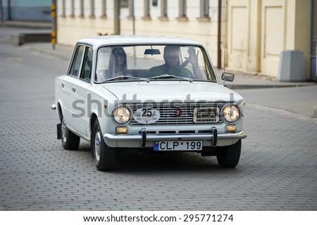 KEDAINIAI - JUNE 20: Soviet car VAZ-2101 Zhiguli on the street on June 20, 2015 in Kedainiai, Lithuania. The VAZ-2101 is a compact sedan car produced by AvtoVAZ. - stock photo