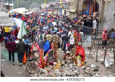 KEDARNATH, UTTARAKHAND, INDIA, MAY 29, 2016: Pilgrims throng the ancient Shiva temple. The temple miraculously escaped the ravages of the 2013 flood that washed away almost all of its surroundings.