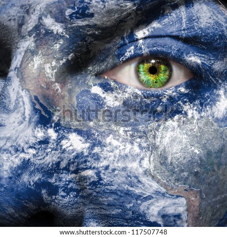 Keep an eye on the world to raise awareness for green energy and sustainability  - Elements of this image furnished by NASA - stock photo