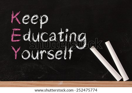 Keep Education Yourself text is written by chalk on blackboard. - stock photo