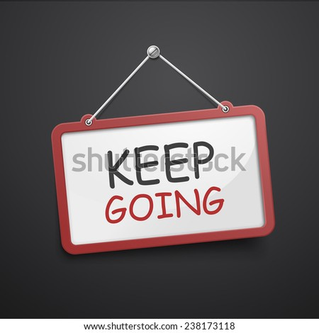 keep going hanging sign isolated on black wall  - stock photo