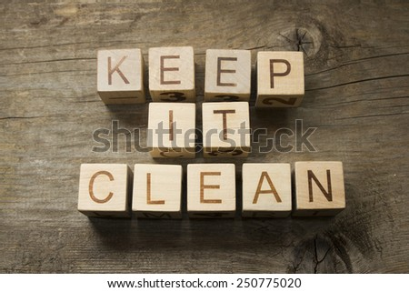keep it clean on a wooden background - stock photo