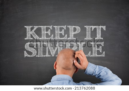 Keep It Simple Concept on Blackboard white text - stock photo