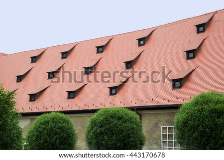 Keep roof with red tiles and layered leveled triple windows sunroof - stock photo