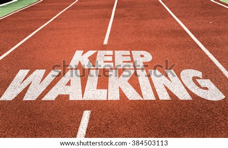 Keep Walking written on running track