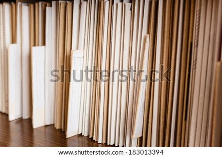 Keeping Records On Yellow Shelves Background - stock photo