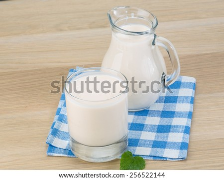 Kefir - milk made dietary product on the napkin - stock photo