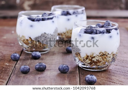 Kefir yogurt and chia parfaits. Kefir is one of the top health foods available providing powerful probiotics. Extreme shallow depth of field.