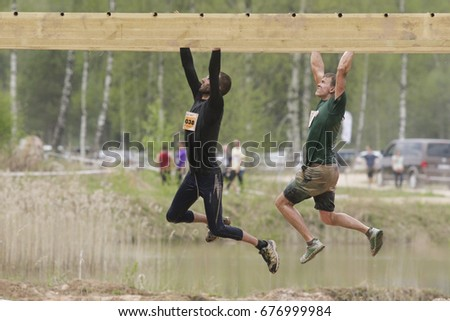 KEGUMS, LATVIA - May 7, 2016: Participants of the strong race 2016. The Strong Race is the bigest extreme mass endurance race in the Baltic States