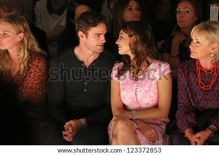 Kelly Brook and Thom Evans at the Issa catwalk show as part of London Fashion Week SS13, London. 15/09/2012 Picture by: Henry Harris