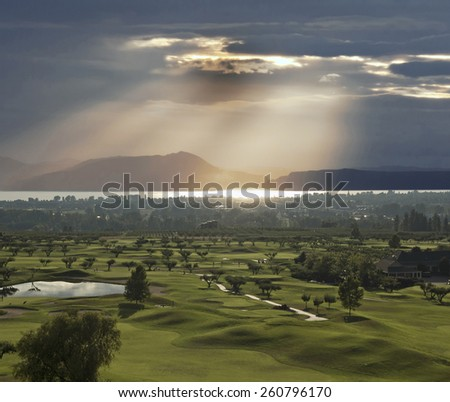 Kelowna and Golf Course by the lake in sunset - stock photo
