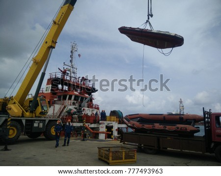 Kemaman, Malaysia - December 17, 2017 : Rescue bot offload from ship to berth.
