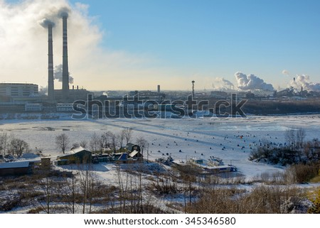 Kemerovo, fishing on the first ice installed of the river Tom - stock photo