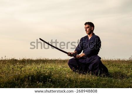 Kendo fighter holding bokuto - stock photo