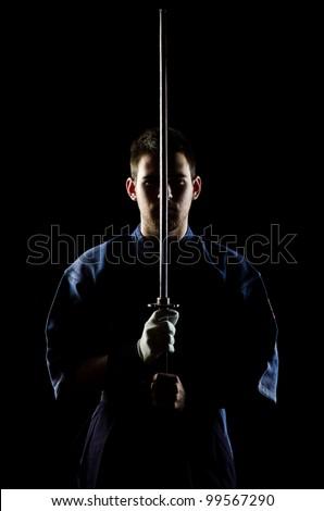 kendo fighter with bokken. studio shot. - stock photo