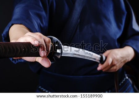 Kendo fighter with sword detail - stock photo