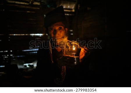 KENG TUNG - JANUARY 24 : women posing in a wooden hut on January 24 , 2015 in Keng tung,Myanmar