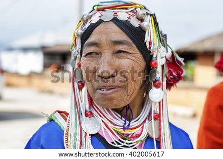 KENGTUNG, MYANMAR - JANUARY 22, 2016: A portrait of an Akha hill tribe woman at Kengtung market. The Akha are an indigenous hill tribe who live in Thailand, Burma, Laos, and Yunnan Province in China.