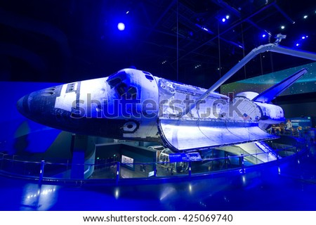 KENNEDY SPACE CENTER, FLORIDA, USA - APRIL 27, 2016: Space Shuttle Atlantis illuminated by blue light at the visitor complex of Kennedy Space Center - stock photo