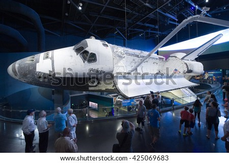 KENNEDY SPACE CENTER, FLORIDA, USA - APRIL 27, 2016: Visitors looking at Space Shuttle Atlantis which is exhibited at the visitor complex of Kennedy Space Center