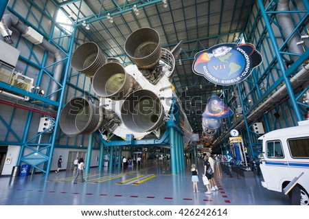 KENNEDY SPACE CENTER, FLORIDA, USA - APRIL 27, 2016: Visitors looking at the Saturn 5 rocket which is exhibited at the visitor complex of Kennedy Space Center - stock photo
