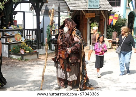 KENOSHA, WI - SEPTEMBER 4: Man with a staff dressed in medieval costume at the annual Bristol Renaissance Faire on September 4, 2010 in Kenosha, WI