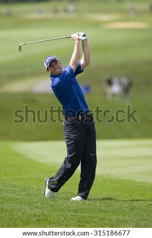 KENT ENGLAND, 27 MAY 2009. David HOWELL (GBR) playing a shot from the 9th fairway playing in the first round of the European Tour European Open golf tournament.