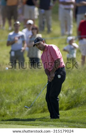 KENT ENGLAND, 31 MAY 2009. Jeev Milkha SINGH (IND) playing a chip shot during the final round of the European Tour European Open golf tournament.  - stock photo