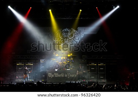 KENT, WA - FEB 21:  Legendary rock singer and bass player Lemmy Kilmister of the Heavy Metal band Motorhead performs on stage during the Gigantour tour on February 21, 2012 in Kent, Washington. - stock photo